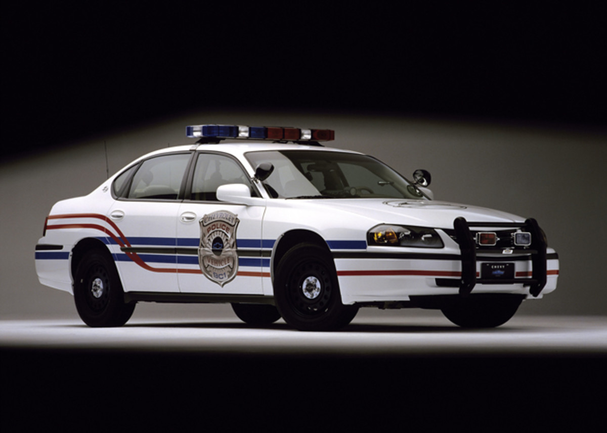The Impala returned for 2000, again as a 4-door sedan only. It was a popular choice for law enforcement use. Shown here is a 2001 model.