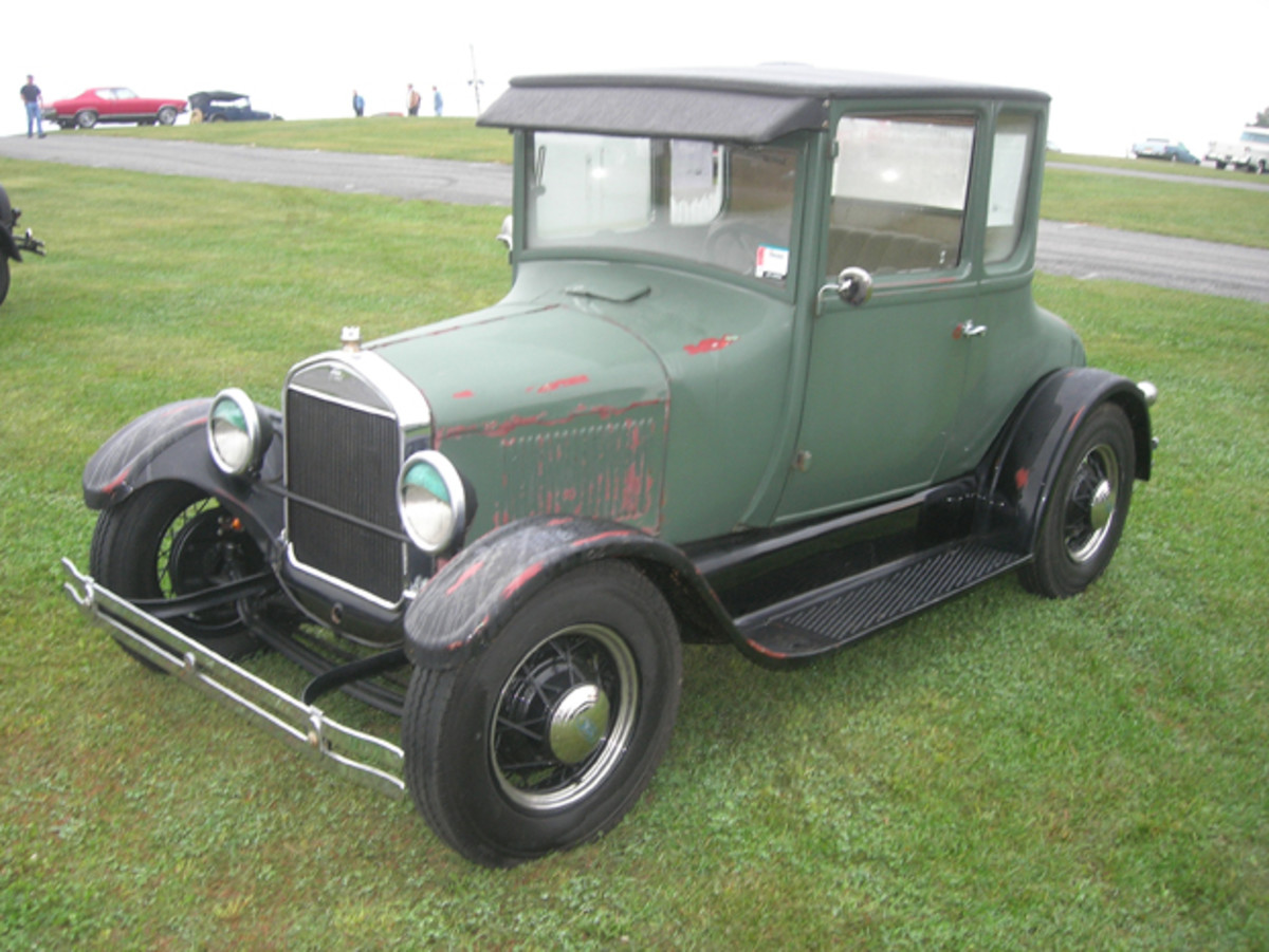 "While appearing stock, this 1927 Ford Model T coupe offered for sale in the car corral was extensively modified, including an updated powertrain consisting of a Ford 2.0-liter four-cylinder engine and five-speed transmission. The coupe's exterior was ""patina'ed"" in stock colors for a worn effect on original ""Henry steel."" Asking price was $19,500."