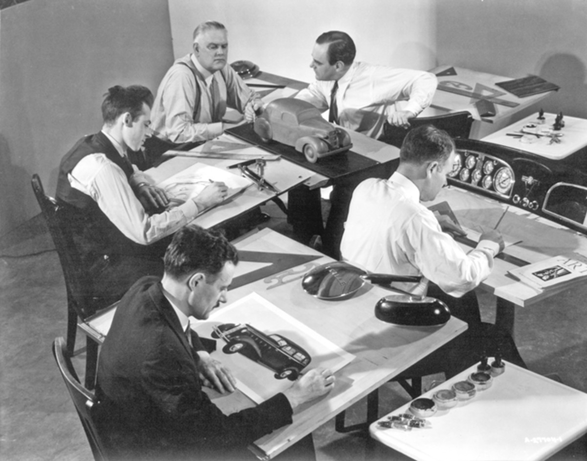 Designers of GM's Art & Colour Section are shown at work on ideas for the 1934 LaSalle in this photograph. At center right is an instrument panel design. Note the scale clay model at top center. By this point, Harley Earl had pushed through his philosophy that every element of an automobile should be styled. (GM Media Archive)