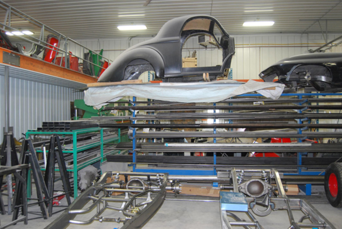 Frames and fiberglass bodies are lined up throughout the JW Rod Garage.