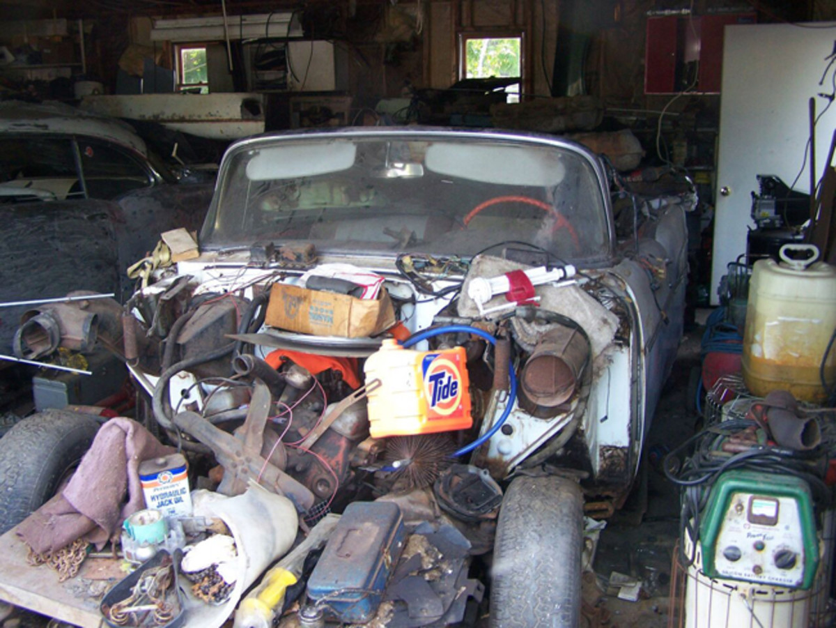 The '57 convertible rests in the garage. It and the hardtop had been in the garage for 40 years.
