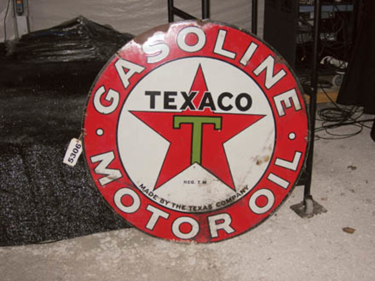 Showing some wear, this circular, two-sided, porcelain Texaco Gasoline/Motor Oil sign sold for $2,000.