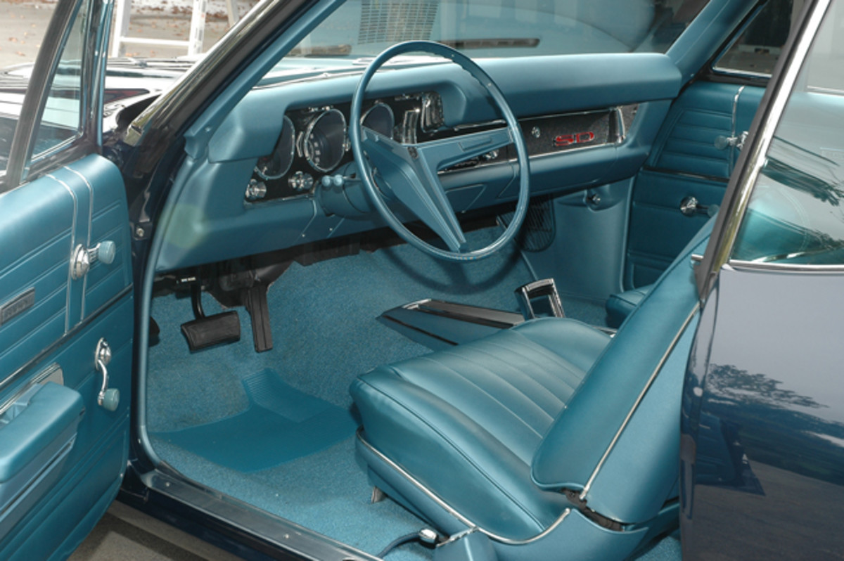 The interior on this Sport Deluxe includes carpeting and a Tempest/Lemans dash layout. The steering wheel is similar to those found in Chevelles.
