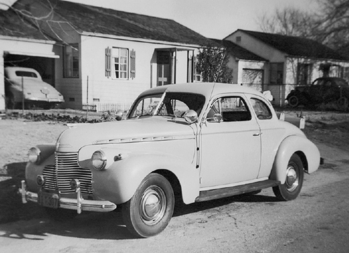 This 1940 Chevrolet is the only image in the lot that shows one of Thomas' own vehicles, a 1940 Chevrolet coupe. It's pictured in Elmonte, Calif. That looks like a ca.-1940 Studebaker coupe poking out of the garage and a parked 1935 Ford coupe in the background.