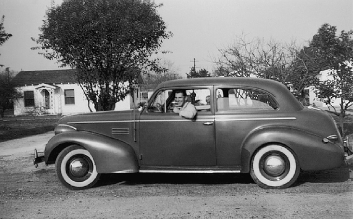 In a profile view, the family resemblance between Chevrolet and Pontiac during 1939 is especially clear. This is a 1939 Pontiac two-door touring sedan, shown with unknown friend of Thomas behind the wheel.