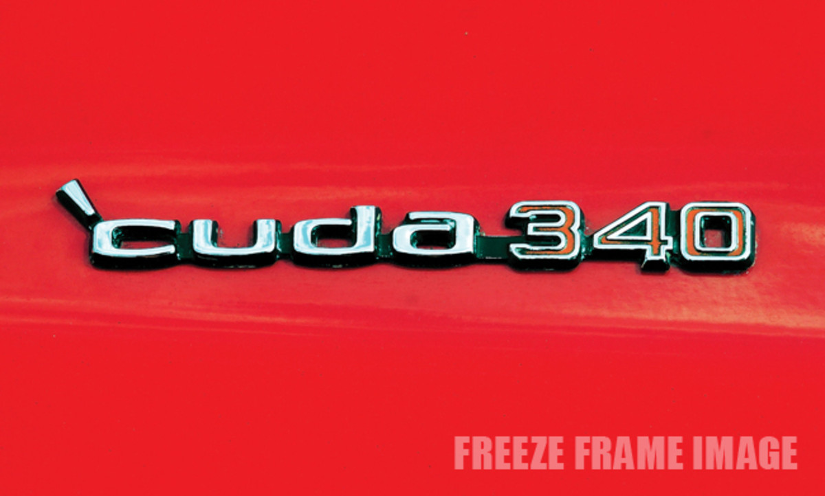Scripts on the hood denote the engine and that this car was the 'Cuda performance version of the Barracuda.