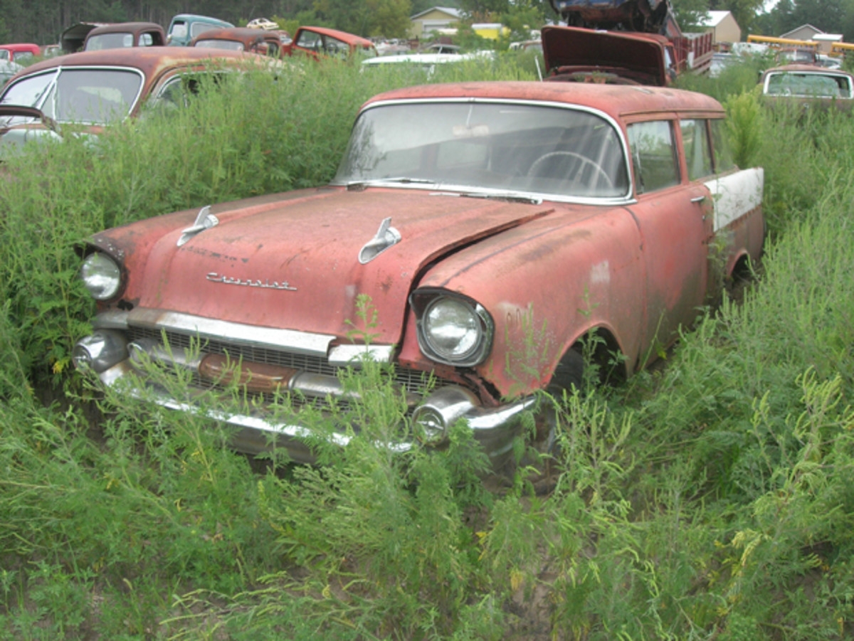 Its desirable side trim has been removed and stored for safe keeping and rust is a problem, but this 1957 Chevrolet 150 Handyman two-door station wagon retains lots of donor-quality parts.
