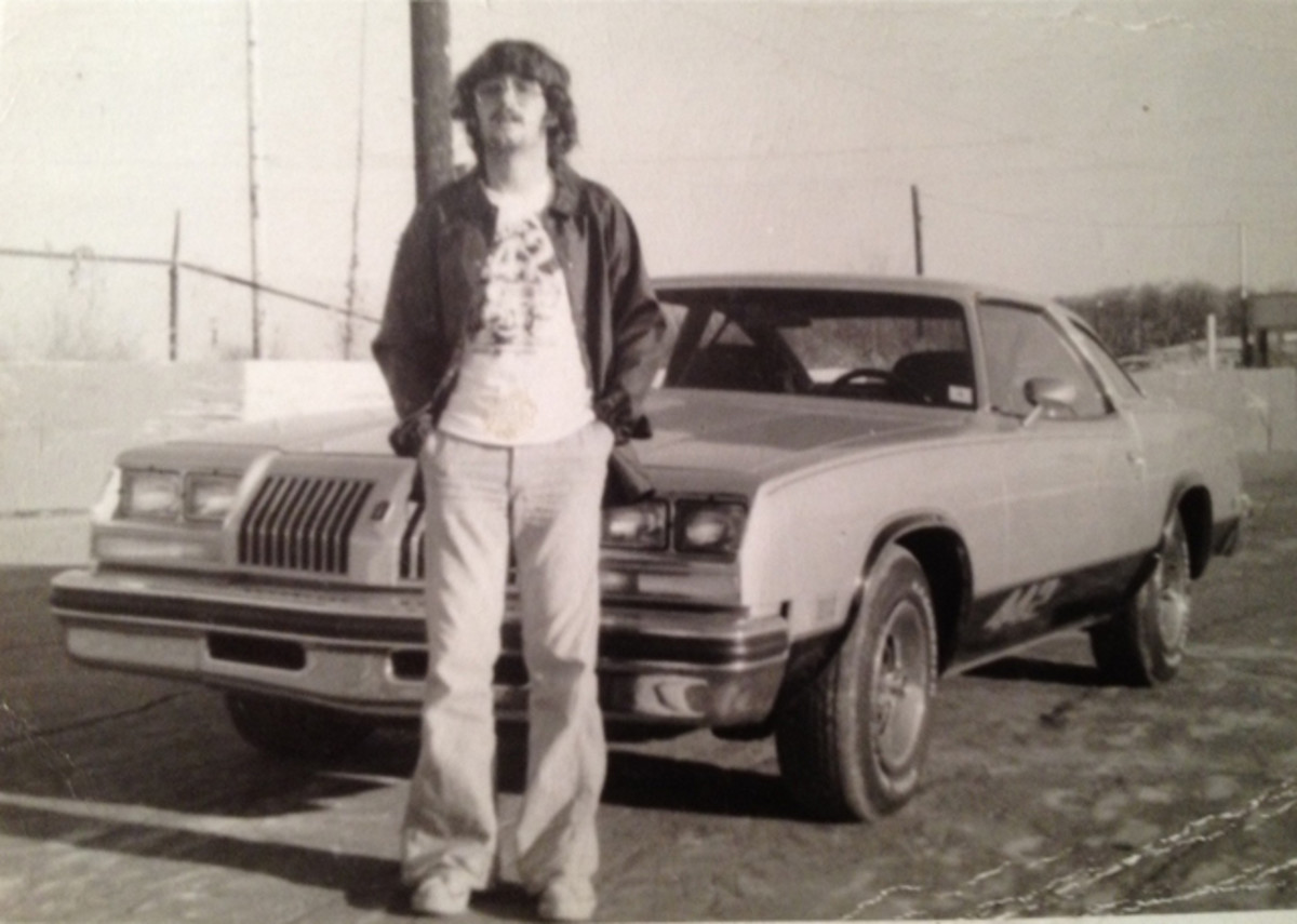 A sign of the times, owner Clifton Cummins posed in his bell bottoms with his 4-4-2 when it was nearly new. More than $2,000 in options — such as bucket seats, console, and Super Stock III wheels — brought the $3998.80 base price of his Cutlass S to $6093.90.