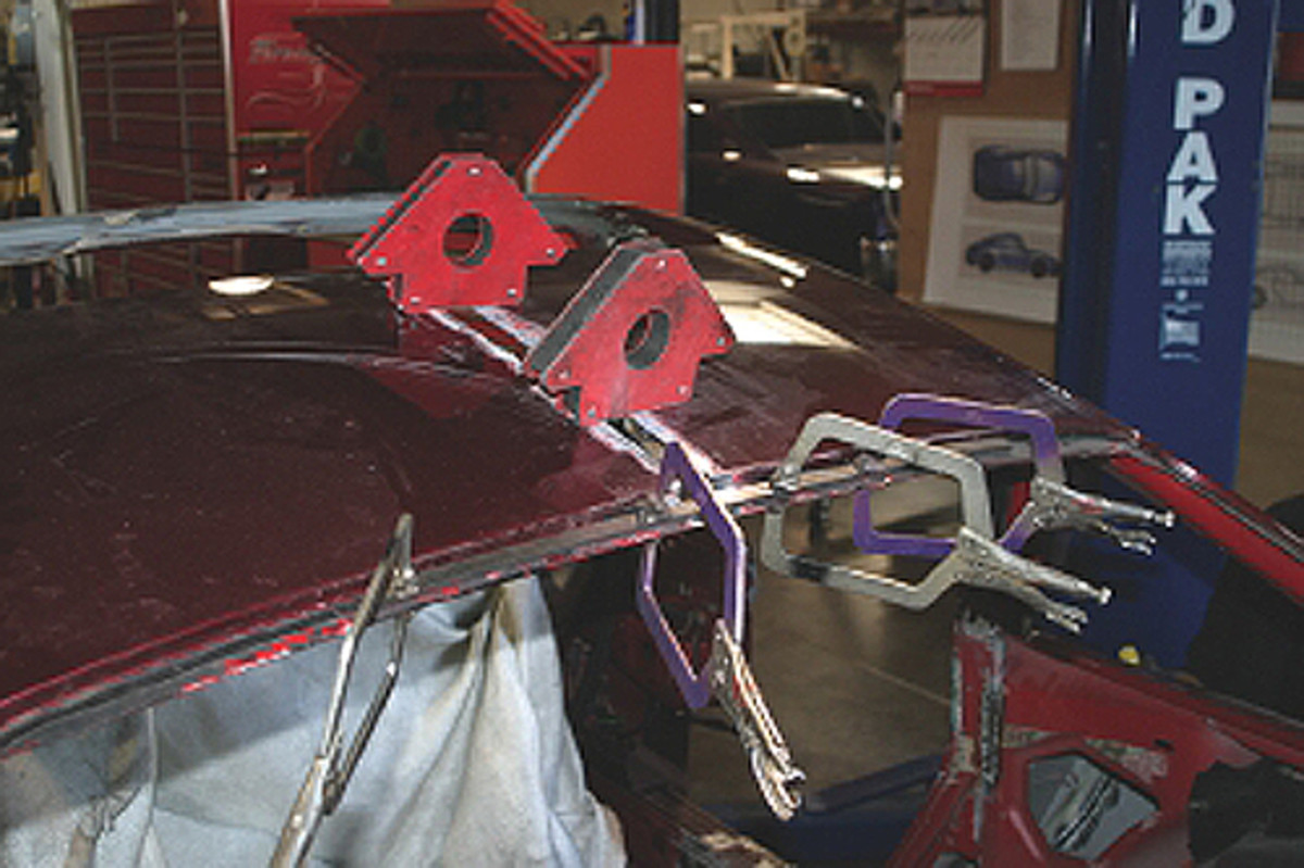This is Sally from the movie CARS. We had to narrow the roof and re-weld it together again, which involved a bit of clamping with magnetic welding clamps to keep the panel alignment.