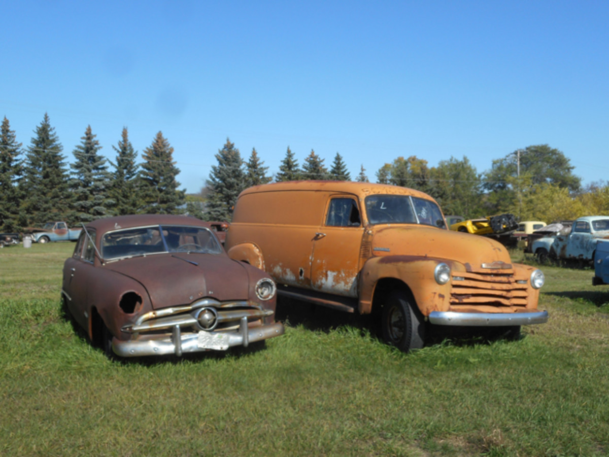 A 1949 Ford and 1947-'53 Chevy 3800 panel truck await their turn under a hobbyist's touch.