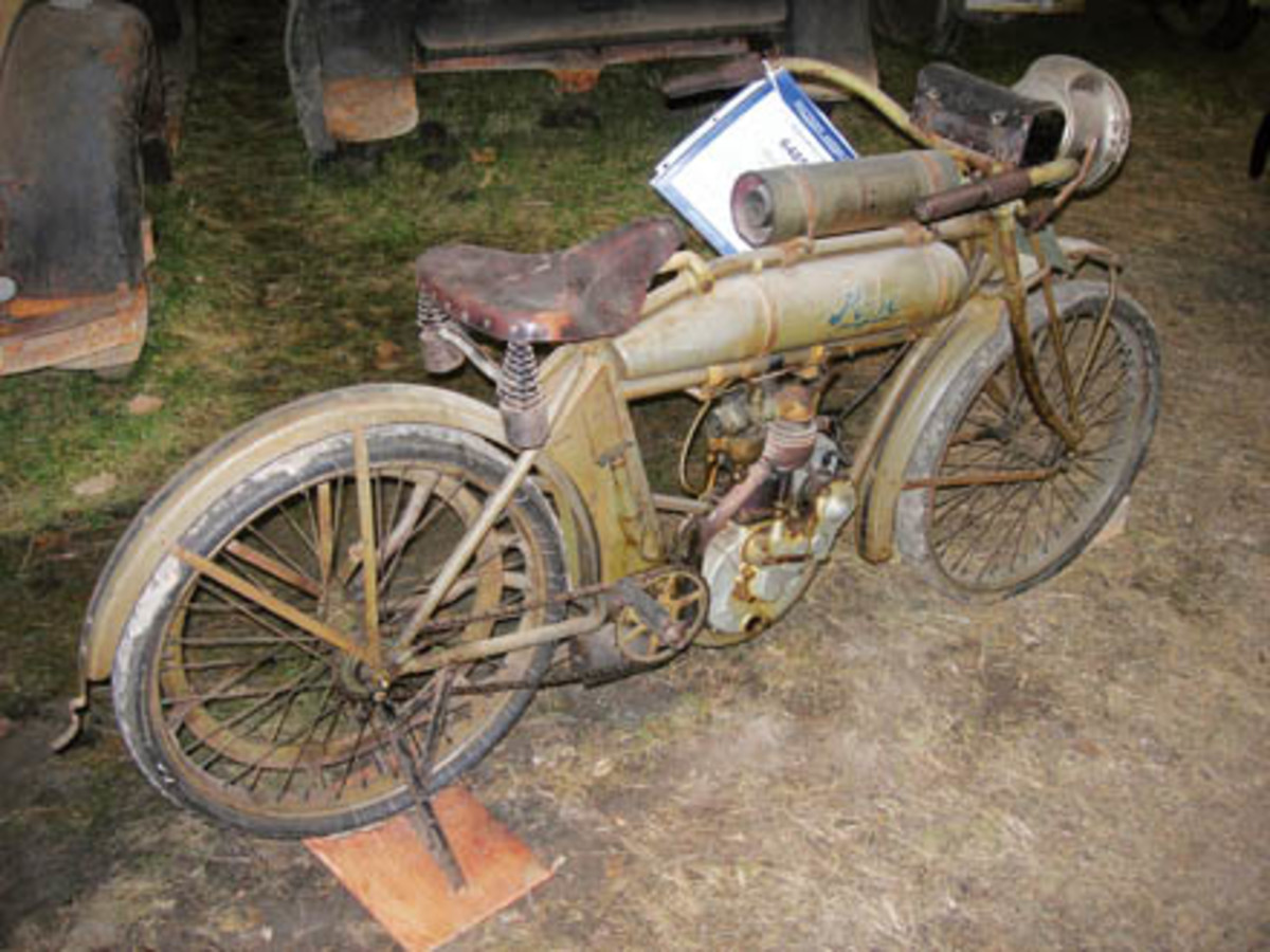 Lee Roy Hartung was just the second owner of this 1911 Pope Model H motorcycle. The original owner's widow stored it for many years in a closet. It sold for $72,500.