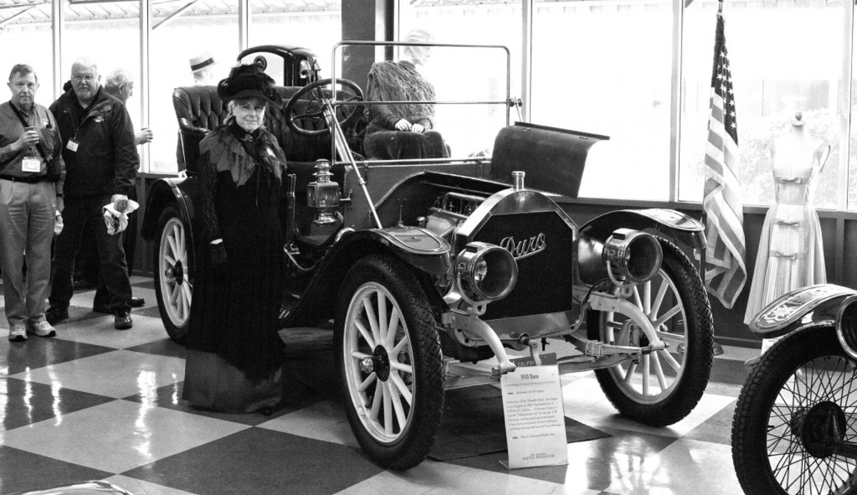 Murphy Museum docent Roberta Fronteras dressed in vintage garb to welcome HCCA visitors. She is standing beside the rare 4-cylinder Duro on display in this Oxnard, Calif., museum.