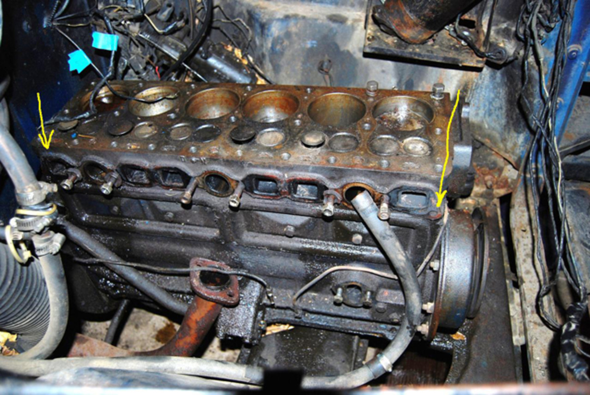 """Yellow arrows point to the locations where Studebaker stopped drilling holes for exhaust manifold studs in the Studebaker Big Six. When rebuilding these motors it is wise to have the manifold """"planed"""" so it's flat and seals well."""