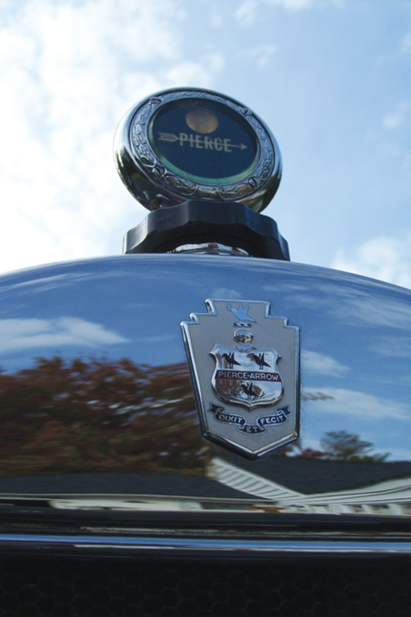 A Pierce MotoMeter rides above a Pierce-Arrow crest, but only in 1928 models. The crest was intended to replicate the Pierce coat of arms, but was quickly removed when Mrs. Percy Pierce notified company officials that it was not the correct coat of arms for her family.