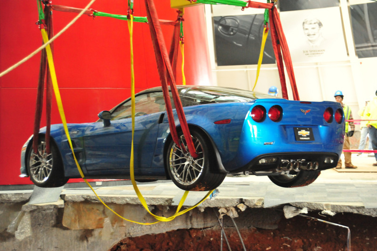 The Corvette ZR1 Blue Devil being lifted out of the sinkhole Monday, March 3. The car was started and driven under its own power after it was retrieved.