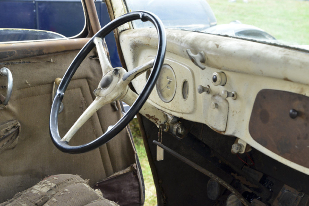 The 1934 Ford's instrument panel is about as simple as possible. The painted surface was new for 1934.