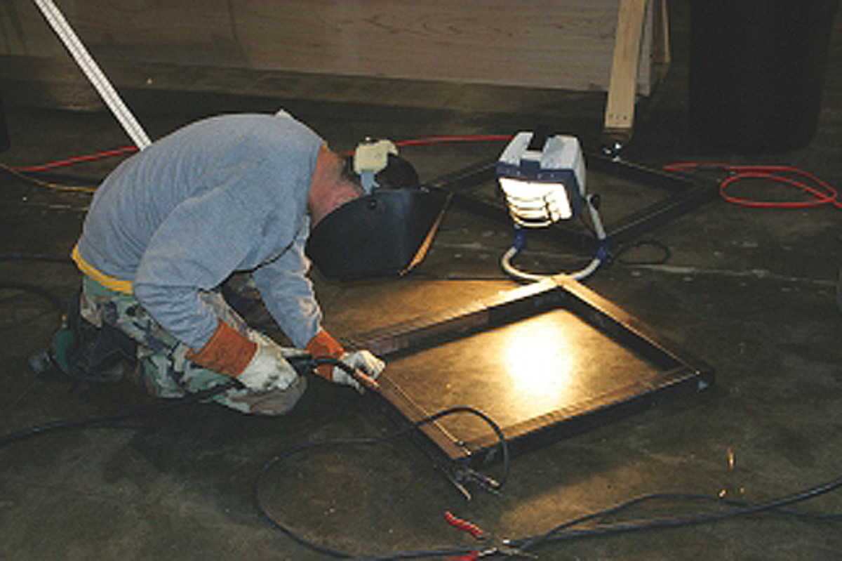 You can light up a welding area with small work lights sold at most hardware stores.