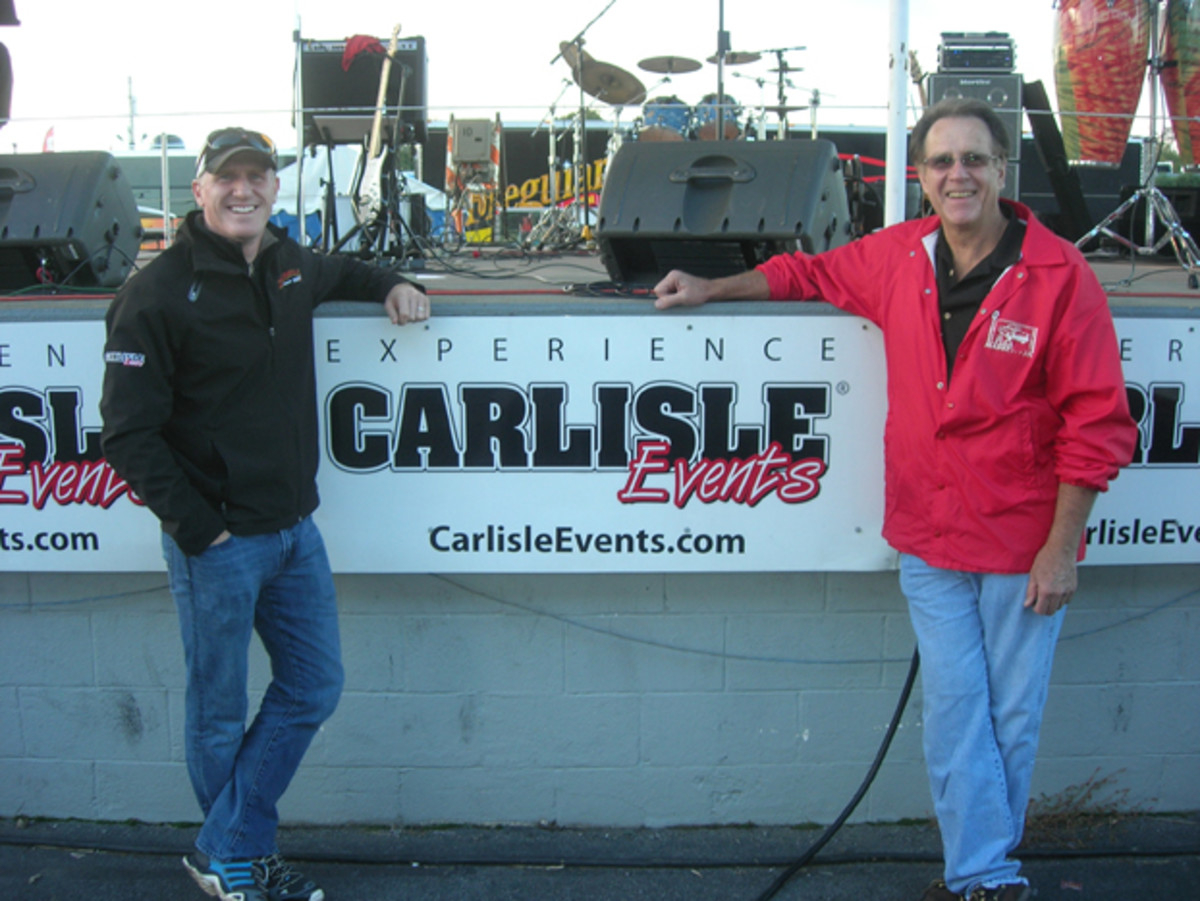 Carlisle Events co-owners (l-to-r) Lance Miller and Bill Miller (no relation) relax during the fall meet's 40th anniversary party where they shared memories of past events with spectators and vendors.