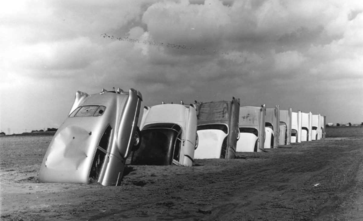 The Cadillac Ranch cars were originally planted in a Texas panhandle pasture near Amarillo; they were moved in 1997 to a new location, still along Interstate 40/Route 66. (Wyatt McSpadden photo)