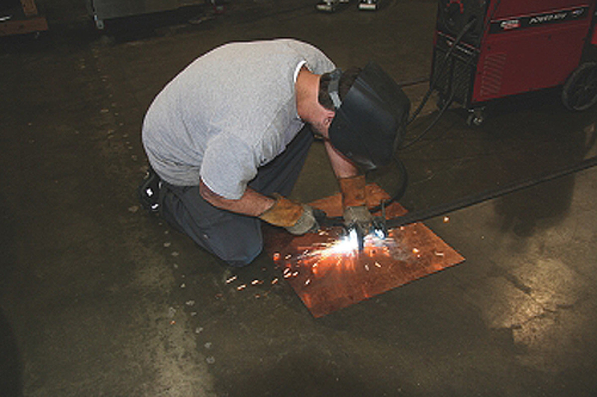 We use a copper plate many times for backing up a weld. The weld won't stick to the copper.