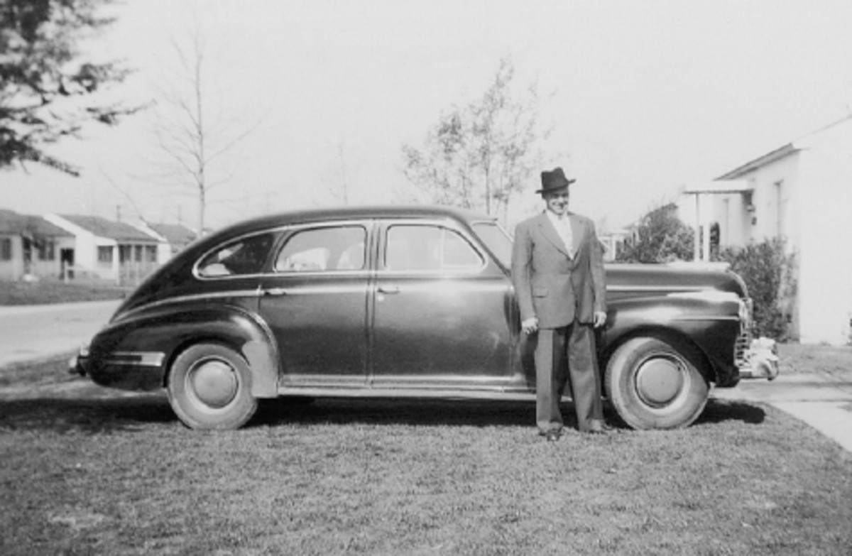 This 1941 Buick is accompanied by Thomas' older brother, Jim. This picture was also taken in Elmonte, Calif.