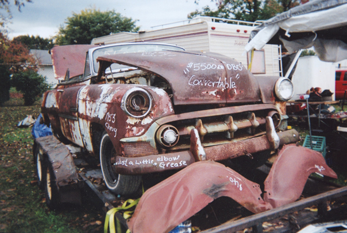 """Vendor Raymond Tucker of Burke, N.Y., offered this 1953 Chevrolet Bel Air convertible for sale for $5,500 in the swap meet. """"Just a little elbow grease"""" chalked on the bumper is optimistic, but the droptop offered plenty of donor parts."""