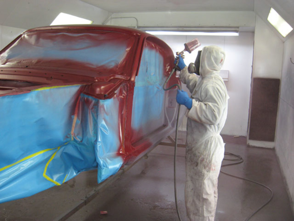 The proper painting equipment should include a full suit and respirator and gloves. Also notice the floor has been wet down to keep dust from floating in the booth during the paint process.