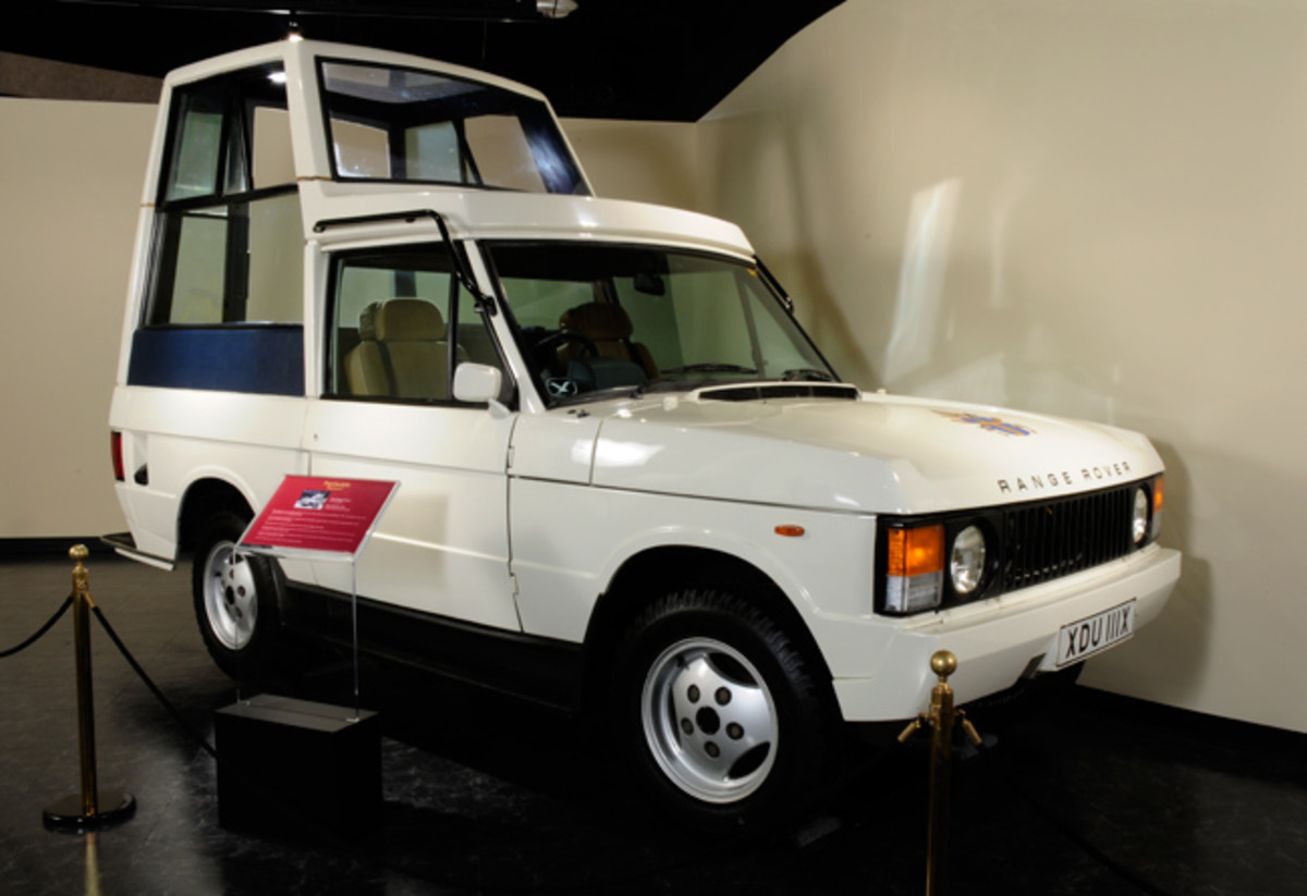 "In 1982, the British design firm of Ogle crafted the first bulletproof Popemobile on a Range Rover chassis. The raised ""telephone booth"" at the rear raises overall height of the car to 102 inches."