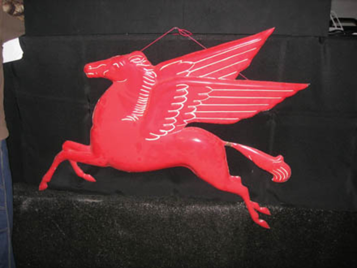 This embossed porcelain Mobil Oil Pegasus sign sold for $3,250.