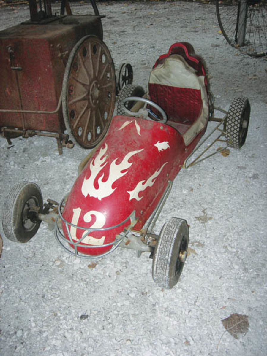 A flame-finished quarter midget race car from the 1950s drew lots of interest from bidders, eventually selling for $3,250.