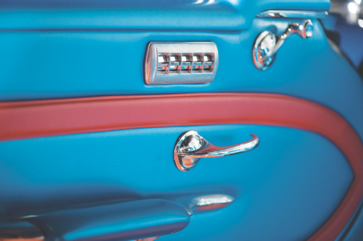 Because this car is uniquely optioned with power periscoping headrests, a five-gang switch was incorporated into the door. Production 1956 Buicks with power windows had four-gang switches in the door (one switch for each window), but the 1956X Century required a five-gang switch, the fifth switch operating the head rest. Because GM removed the custom seats before the car was sold, it had installed a four-gang switch on the door panel, but once the interior panel was off, Mayton found the hole in the door for this switch was enlarged to accommodate the five-gang switch. Mayton had to make this switch. Note the design of the custom door handle is like that of a 1957 Buick Super.