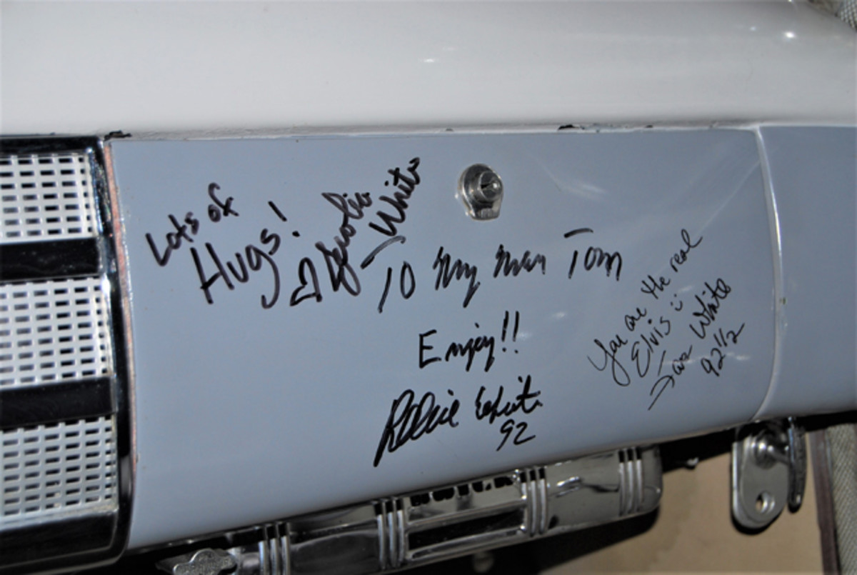 The glove box door has been signed by members of Reggie White's family.