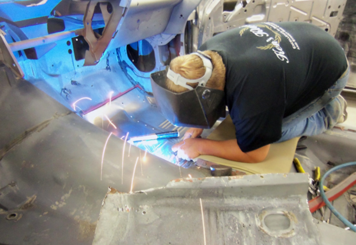 Josh Wiser welds in the new floor pan on the passenger side.