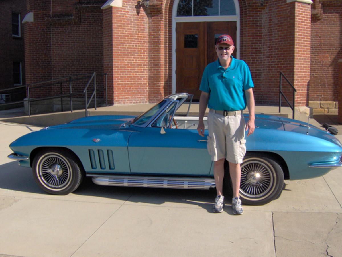 Ammon standing next to his 1965 Chevrolet Corvette convertible