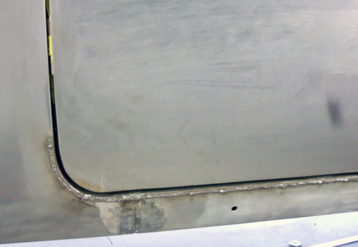 On the rocker and rear quarter panel, a horizontal cut was made and filled with weld to make the door gap better. We also cut around the corner to make the radius of the door opening fit the radius of the door.