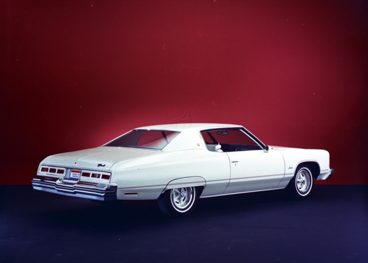 "While Chevy went with the ""Colonnade"" design for the Caprice, Impala hung on to the hardtop through 1975. Shown here is the special edition 1974 Impala dubbed ""Spirit of America."" It featured white paint and upholstery, special pin striping, fender skirts, and wheels borrowed from Pontiac."