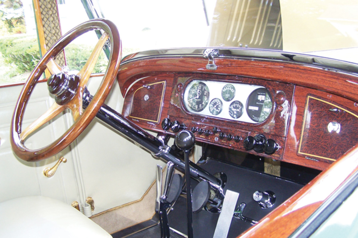 The Series 36 Pierce-Arrows were notable for their excellent woodwork, clearly visible on the instrument panel and rich steering wheel, both masterfully restored to a deep luster on this sedan.