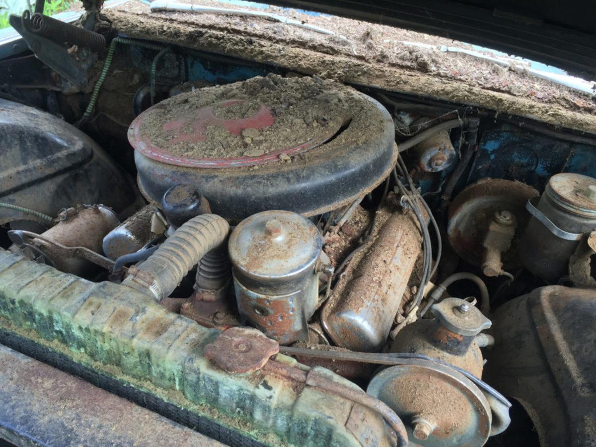 "The chromed engine of the ""flat top"" 1959 Sedan deVille."