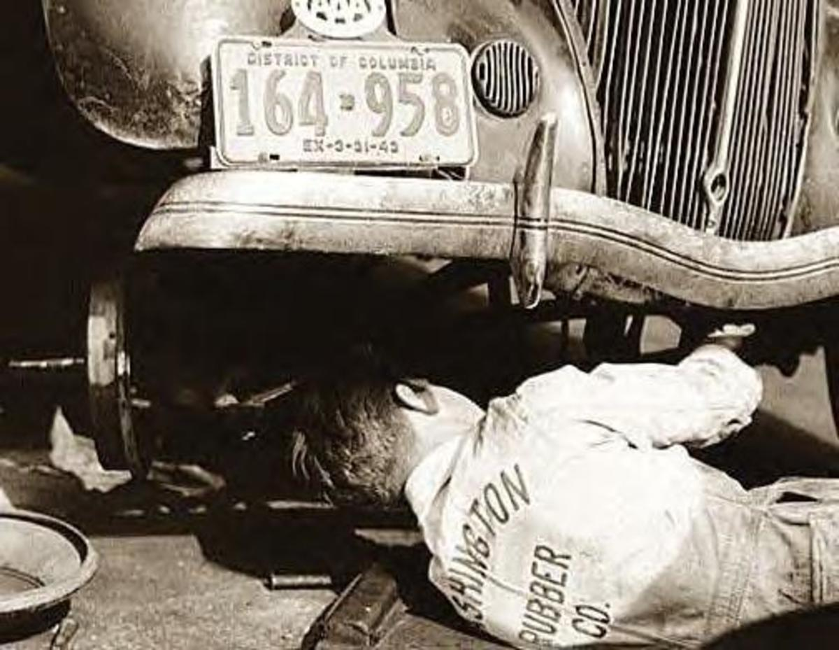 Back in 1943 this mechanic in Washington, D.C. was tinkering with a car that didn't want to be fixed.