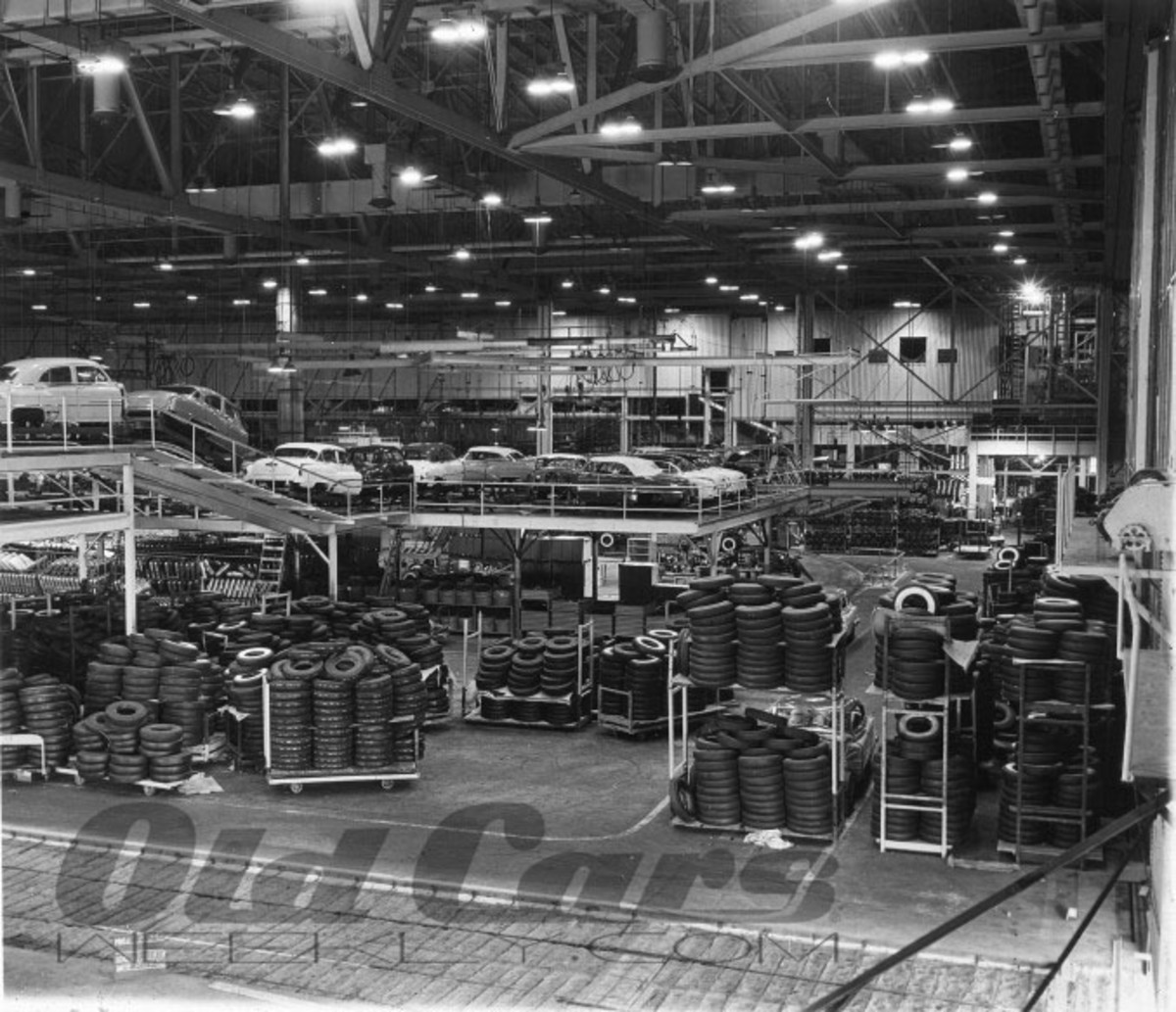 Trimmed bodies in a mix of 1952 B-O-P models travel down the line at General Motors' Fairfax, Kan., plant, waiting to be mated with chassis. The blackwalls in the foreground appear to greatly outnumber the whitewall tires.