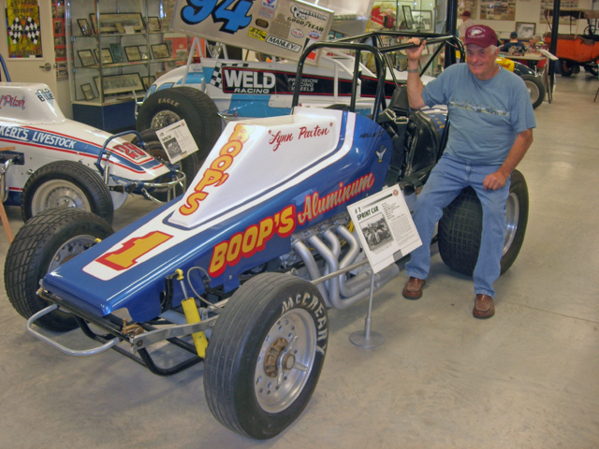 EMMR president Lynn Paxton shows off one of the sprint cars that carried him to his many victories on the rough-and-tumble Pennsylvania dirt track circuit. The sprinter is among the more than 80 race cars on display in the museum.