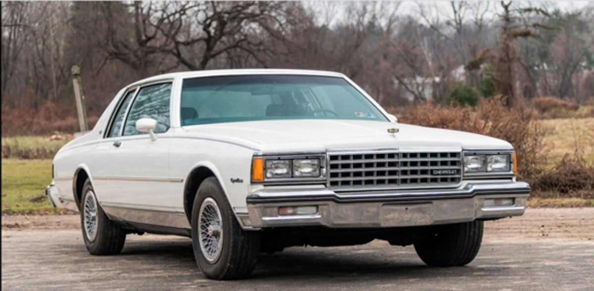 The white 1984 Caprice Sport Coupe with blue interior on offer at the 2019 Mecum Auctions Kissimmee sale. This 13,000-mile example appears to lack its original tires and corrosion visible in pictures makes it appear as though it hasn't been stored as well as the black coupes. Mecum Auctions photo
