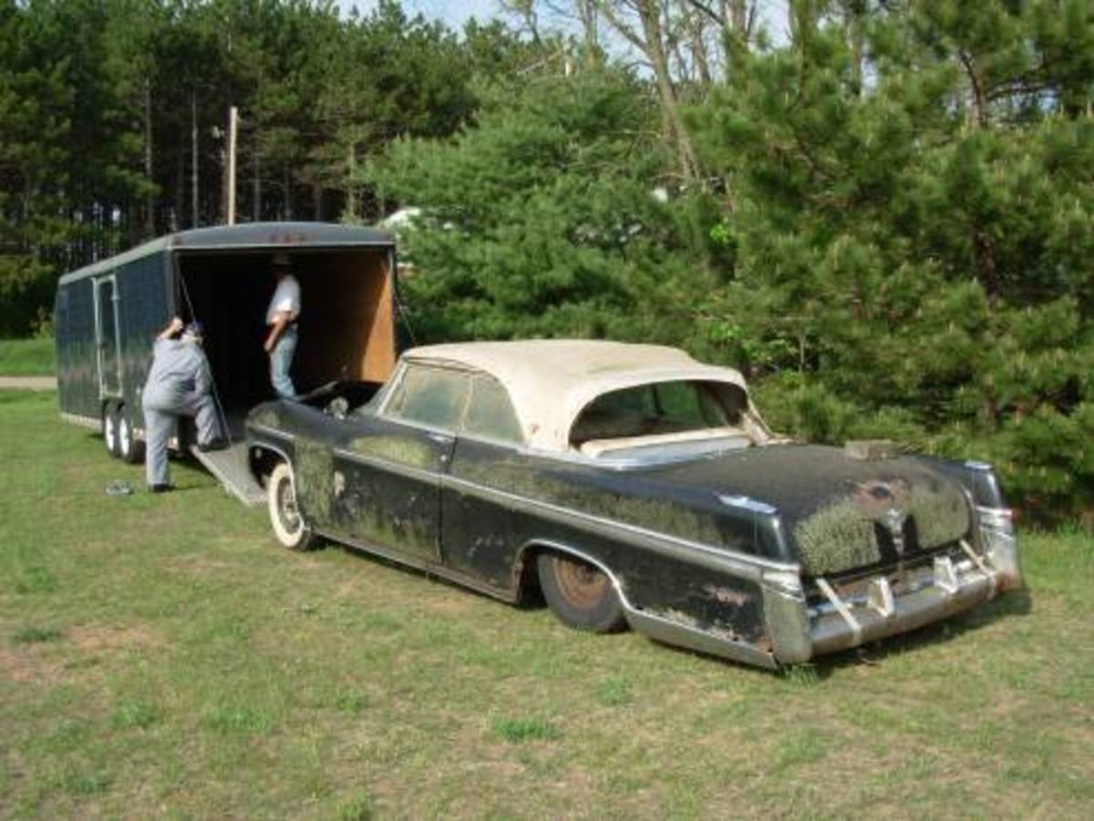 The 1956 imperial begin moved from its longtime place of outdoor storage.