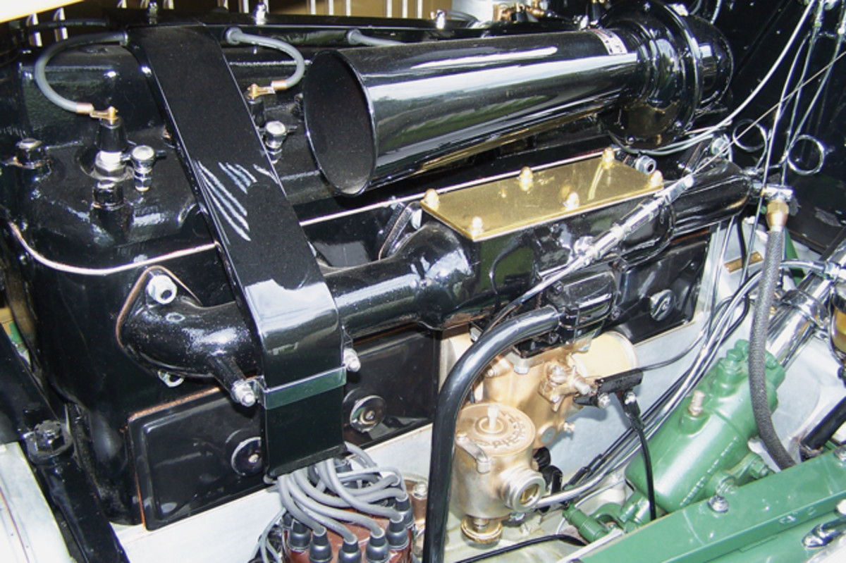 At left is the 414-cid, T-head six-cylinder engine of Ferrara's 1928 Pierce-Arrow Series 36. Notice the Pierce-Arrow name on the fuel pump and the twelve spark plugs in the distributor cap for the dual-valve engine.