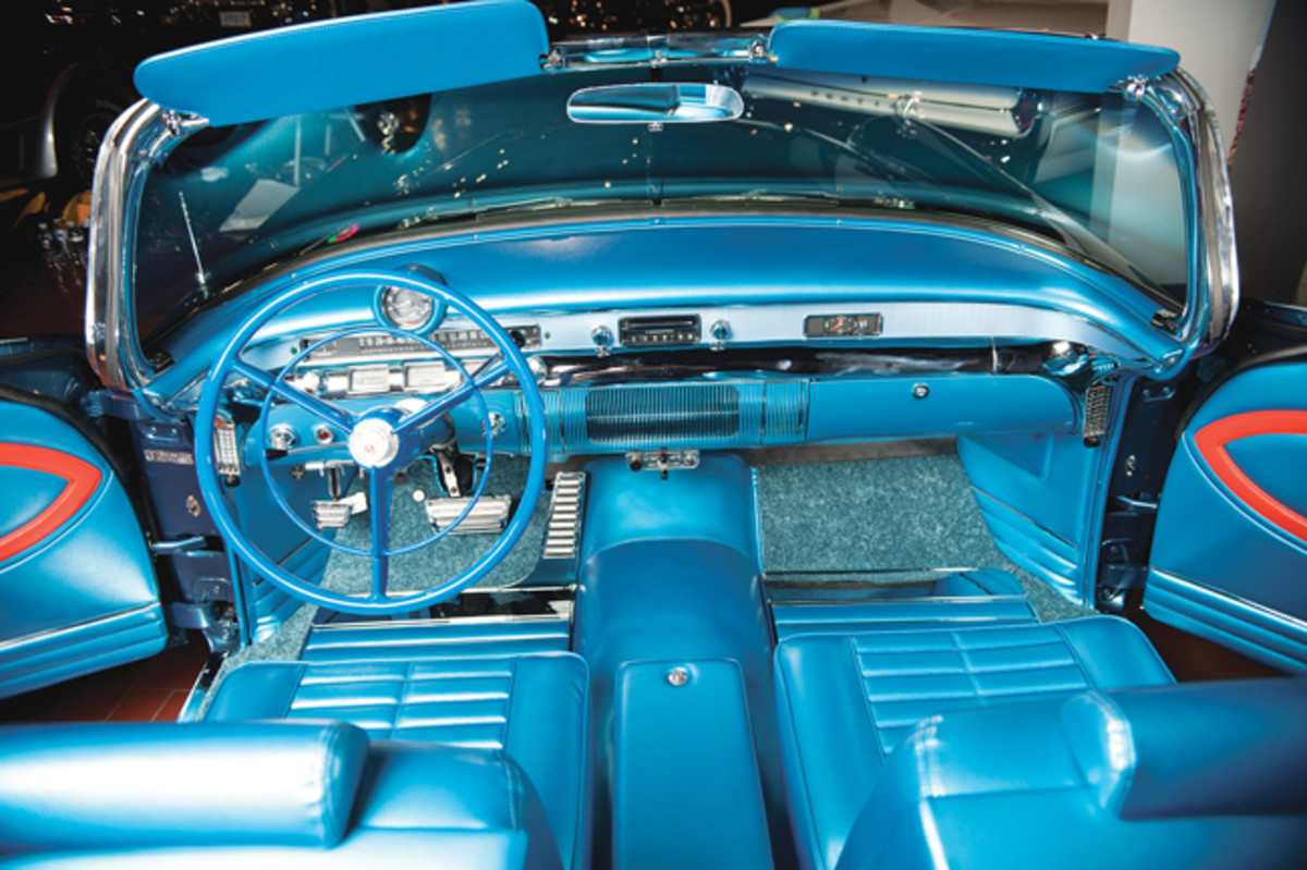 Inside is where the Century X really dazzles. Notice the all-blue steering wheel, the tachometer on the dash, the chrome foot pedals, the deep pile carpet, the bucket seats and the console.
