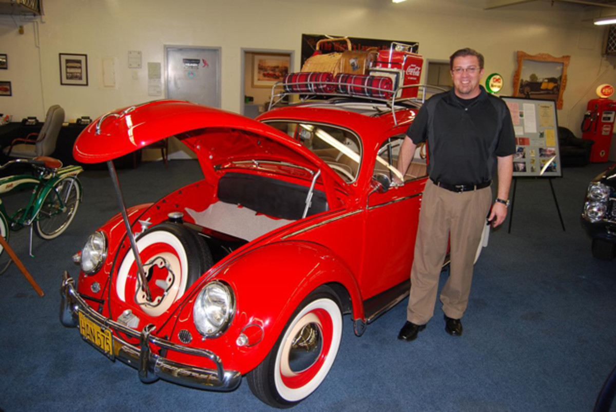 Rob Williams with his bright red VW at The Auto Collections in Vegas.