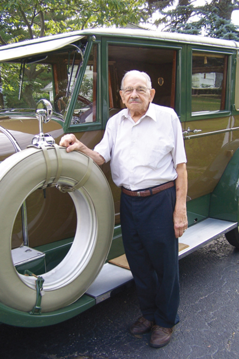 Owner Al Ferrara stands besides his imposing 1928 Pierce-Arrow Series 36 sedan. Only a handful of these top-of-the-line Pierce-Arrows survive.