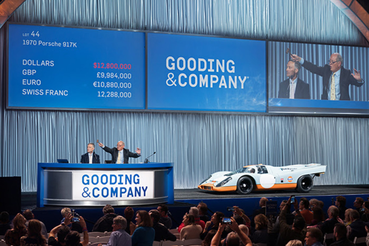 (L-R) President David Gooding and Auctioneer Charlie Ross sell the 1970 Porsche 917K for a world record price of $14,080,000. Image copyright & courtesy of Gooding & Company. Photo by Jensen Sutta.