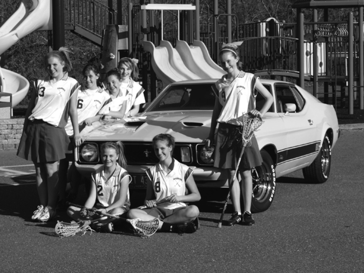 Hatcher's daughter, Lynne (far right), and her Lacrosse team are Mustang fans. Lynne was along when her father discovered the car.
