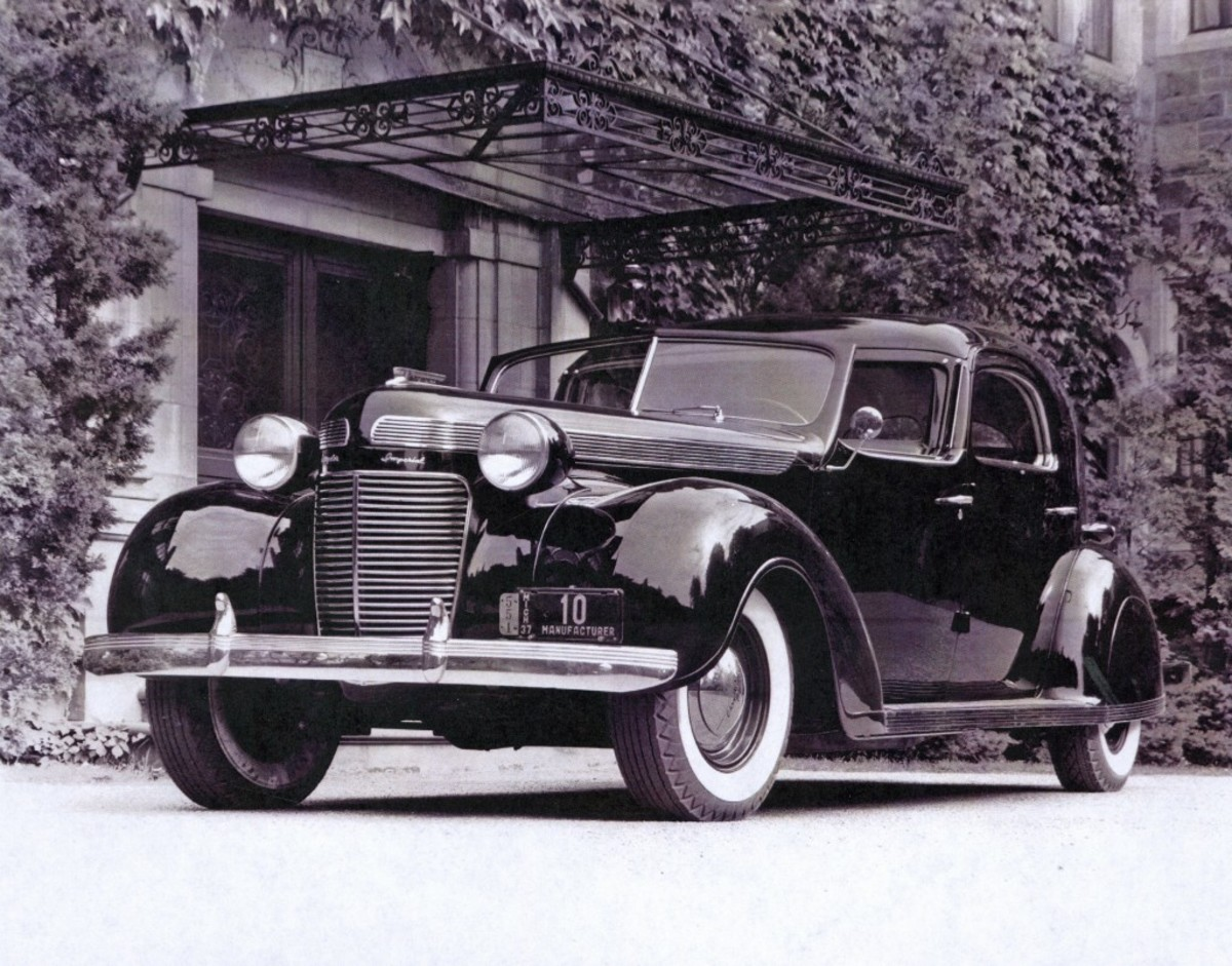 Period photos show the LeBaron-bodied 1937 Chrysler town car built for Mrs. Walter P. Chrysler. The car is a study in streamlining during the Art Deco era, with harmonizing speed lines throughout the entire design.